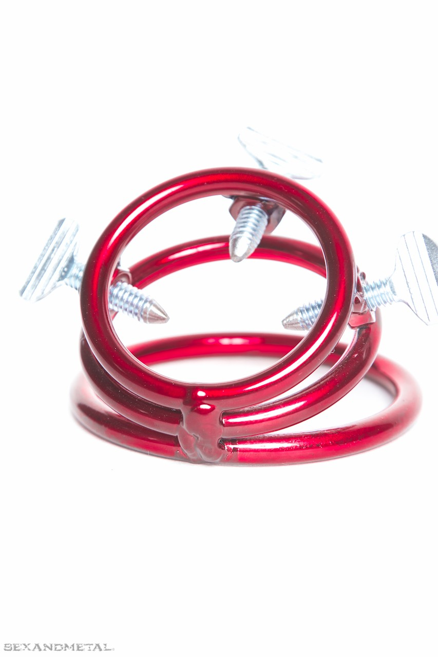 CBT device, the thrice screwed cock ring in a red steel finish