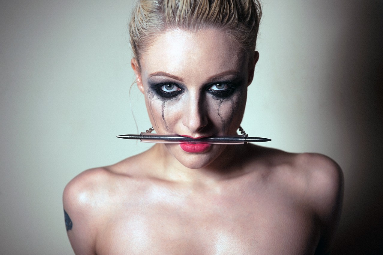 bit gag by sex and metal. model wearing bite gag is quintis