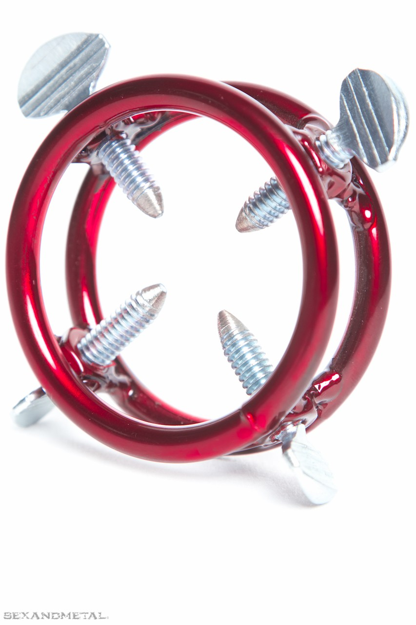 the screwed cock ring for cock and ball torture. Red